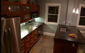 small kitchen designed with concrete countertops and silver