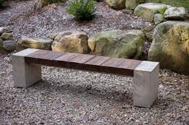 Wood Concrete And Metal Merge In This Bench Made Of Reclaimed - Ipe outdoor furniture