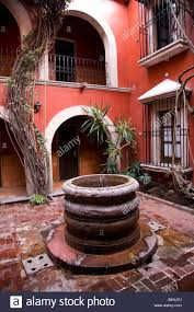 Spanish Style Courtyards spanish style courtyard and well morelia mexico stock photo