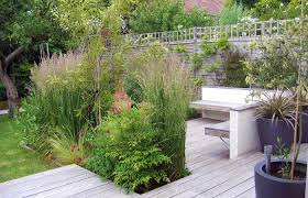 small family garden design small narrow garden design ideas wooden decking like the bench