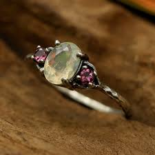 tourmaline opal oval faceted opal ring with pink tourmaline side set discovered