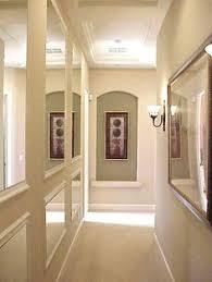how to make a dark narrow hallway look bigger hallway mirror