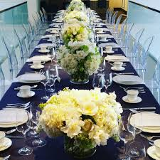 residential dinner party ghost chairs navy blue linens gold