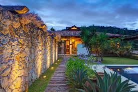 exterior wonderful stone fence backyard with yellow lighting