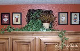 top of kitchen cabinet decor ideas decorative items to put on top of kitchen cabinets storage above