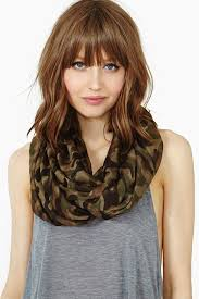 layered medium lenght hair with bangs stylenoted hairstyle to start the new year with a bang the