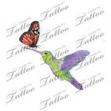 marketplace brightly colored hummingbird w a monarch