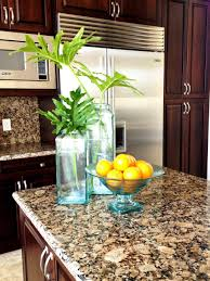 kitchen stone countertop options with decorative plants fruit