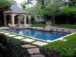 dive into luxury with this large rectangular swimming pool and its