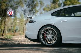 porsche panamera turbo custom white panamera turbo swipes right on brushed titanium wheels