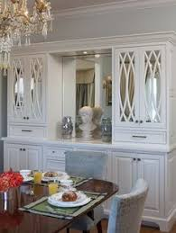 Gorgeous Dining Room Features A Builtin Sideboard Under Art - Built in dining room cabinets