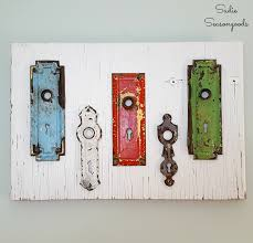 Repurpose Cabinet Doors by Diy Wall Decor With Repurposed Vintage Key Plates On Salvaged Wood