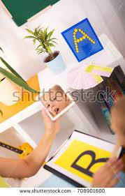 speech therapist teaches boys say letter stock photo 501262033