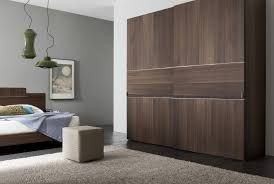 Designer Closet Doors Captivating Bedroom With Minimalist Furniture Layout Using Wooden