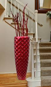 red floor vase with modern vas and laminate flooring and stairs