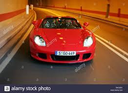 convertible porsche red car porsche carrera gt model year 2005 red convertible open