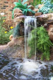 Interior Waterfall Design by Decoration Nice Green Plants With Cute Yellow Flowers Also With