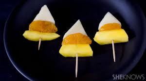 candy corn inspired fruit skewers are a healthy halloween treat
