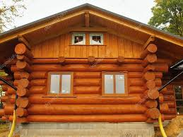 cabin houses front side of new built beams in cabin house painted wood with