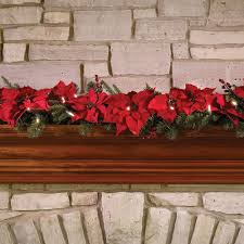 the cordless prelit poinsettia garland hammacher schlemmer