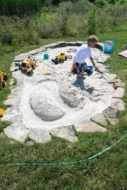 husband built this kidney shaped stacked flagstone sandbox it u0027s