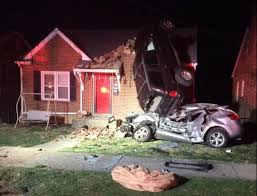 car nearly lands on the roof of a virginia house after accident