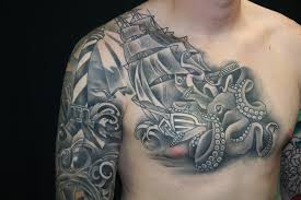 black and gray ocean fish water sleeve and chest tattoo by brandon