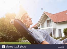 Chair In Garden Relaxed Woman In Deck Chair In Garden Stock Photo Royalty Free