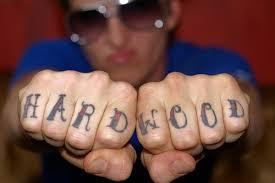 tattoos of humming bird finger words