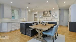 pictures of kitchens with islands kitchen featuring an island with bench seating omega