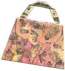 mirkwood designs artistry in rubber purse