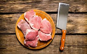 meat cutting table tops pieces of raw meat with knife on cutting board stock photo image