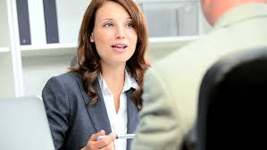business greeting financial advisor greeting business client in office