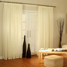 shiny interior living space with wooden table and rattan ottoman near french door curtains
