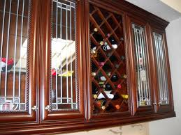 secrets to making your kitchen look bigger cabinet wholesalers built in wine storage in custom kitchen cabinets