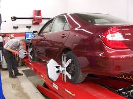 bmw x5 alignment cost is getting my car aligned after a strut or shock install really