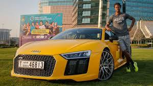 Audi R8 Yellow - gael monfils tests an audi r8 dubai duty free tennis championships