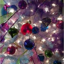 colored ornaments ribbons and mesh make a white