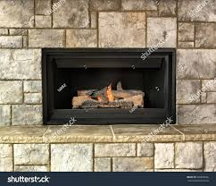 natural gas fireplace logs vented stock photo burning surround