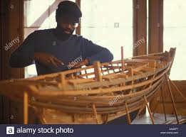 american craftsman an african american craftsman builds a large scale wooden boat