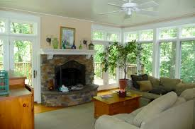 living room sunrooms with fireplace decoration using large