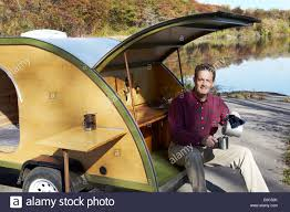 Retro Camper Middle Aged Man Camping In Retro Camper Stock Photo Royalty Free
