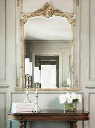 photos hgtv antique table and gilt mirror in neutral hallway