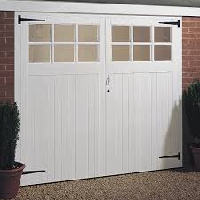 Costco Garage Doors Prices by Outdoor White Paint Costco Garage Doors With Decorative Plant On