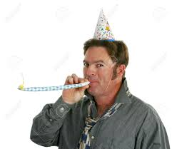 noisemakers for new years a happy at a new years party blowing a noisemaker and