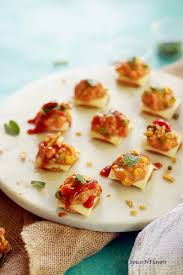 indian canapes ideas cheesy monaco bites monaco biscuit topping spices n flavors