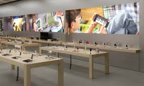 apple livens up retail stores with backlit wall graphics from tv ads