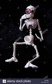 skeleton halloween background skeleton puppet with magnifying glass on black background stock