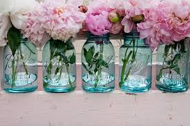 blue mason jar wedding centerpieces with pink and white flowers