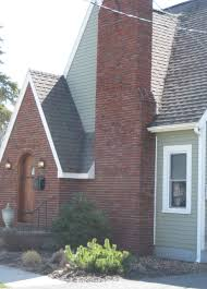 brick tudor siding trim and roof color roof colors bricks and